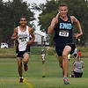 Enid cross country runner, Damion Starr, out sprints Capital Hill's Adrian Jaramillo for second place during the Enid Invitational Tuesday August 15, 2017. (Billy Hefton / Enid News & Eagle)