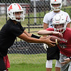 Angel Gonzales runs the option with Caleb Haynie during the first day of practice Monday August 7, 2017 at medford High School. (Billy Hefton / Enid News & Eagle)