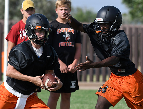 Fairview's Jesse Doty (left) runs the option with Jadon Jones during practice Wednesday August 9, 2017. (Billy Hefton / Enid News & Eagle)