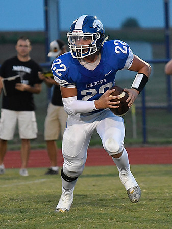 Gavin Smith of Covington-Douglas scrambles away from pressure during the opening game of the season against Timberlake at Covington-Douglas High School AUgust 24, 2017. (Billy Hefton / Enid News & Eagle)