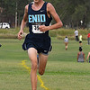 Enid cross country runner, Kyler Clark, crosses the finish line first during the Enid Invitational Tuesday August 15, 2017. (Billy Hefton / Enid News & Eagle)