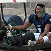 Enid's Will Phillips is carted off the field after injuring his leg during the first quarter against Guthrie Friday August 25, 2017 at D. Bruce Selby Stadium. (Billy Hefton / Enid News & Eagle)