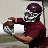 Pioneer's Cody McVey catches a pass during practice at Pioneer High School Tuesday August 8, 2017. (Billy Hefton / Enid News & Eagle)
