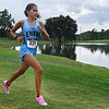 Enid cross country runner, Alexazandria Hernandez, runs pass the lake on the NOC Enid campus Tuesday August 15, 2017 during the Enid Invitational. (Billy Hefton / Enid News & Eagle)