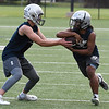Mason Skrimager hands off to Jaden Dimarcut during the first day of practice Monday August 7, 2017 at D. Bruce Selby Stadium. (Billy Hefton / Enid News & Eagle)