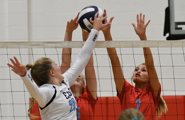 Chisholm's Brookly Wilson and Cameron Massen block the ball of Enid's Catherine Cunningham Tuesday August 21, 2018 at the NOC Mabee Center. (Billy Hefton / Enid News & Eagle)