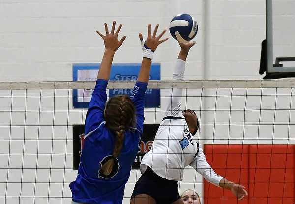 Enid's D'Sani Levy hits the ball against Stillwater's McKenzie Vilade Tuesday August 28, 2018 at the NOC Mabee Center. (Billy Hefton / Enid News & Eagle)