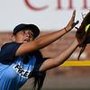 Enid's Kylee Stanley makes a running catch in leftfield against Tulsa Union Monday August 20, 2018 at David Allen Memorial Ballpark. (Billy Hefton / Enid News & Eagle)