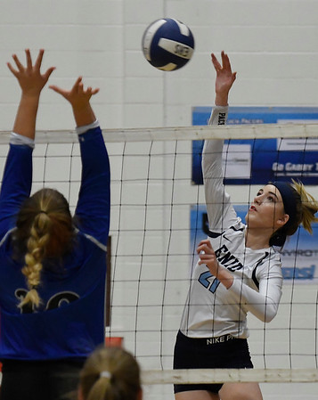 Enid's Emily Peterson hits the ball against Stillwater's McKenzie Vilade Tuesday August 28, 2018 at the NOC Mabee Center. (Billy Hefton / Enid News & Eagle)
