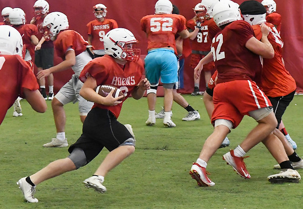 Chisholm's Lane Smith runs the ball during practice Friday August 10, 2018 at Chisholm High School. (Billy Hefton / Enid News & Eagle)