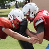 Chisholm player bang heads during the first day of practice with pads Friday August 10, 2018 at Chisholm High School. (Billy Hefton / Enid News & Eagle)