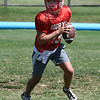 Chisholm's Braden Meek rolls out of the pocket during practice Thursday August 30, 2018 at Chisholm High School. (Billy Hefton / Enid News & Eagle)