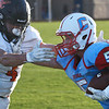 Chisholm's Cody Henderson tries to fend off Fairview's Chad McGolden August 31, 2018 at Chisholm High School. (Billy Hefton / Enid News & Eagle)