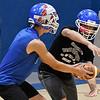 Waukomis' Devin Wagoner takes the handoff from Matt Buck Thursday August 16, 2018 inside the Waukomis Indoor Practice Facility. (Billy Hefton / Enid News & Eagle)