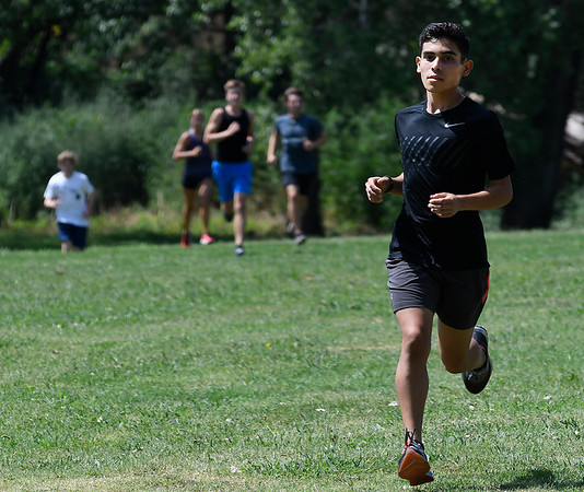 Enid's Anthony Carranza during cross country practice Wednesday August 8, 2018 at Northern Hills Golf Course on the NOC campus. (Billy Hefton / Enid News & Eagle)