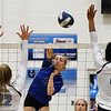 Stillwater's Audrey Riley hits the ball between Enid's Catherine Cunningham and D'Sani Levy Tuesday August 28, 2018 at the NOC Mabee Center. (Billy Hefton / Enid News & Eagle)