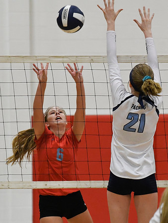 Chisholm's Brookly Wilson tries to hit the ball over Enid's Emily Peterson Tuesday August 21, 2018 at the NOC Mabee Center. (Billy Hefton / Enid News & Eagle)