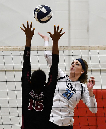 Enid's Emily Peterson hits the ball against Putnam City North's Jazmin Myers Tuesday August 7, 2018 at the NOC Mabee Center. (Billy Hefton / Enid News & Eagle)