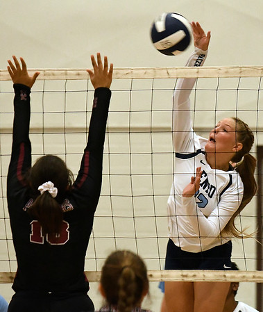 Enid's Catherine Cunningham hits the ball against Putnam City North Tuesday August 7, 2018 at the NOC Mabee Center. (Billy Hefton / Enid News & Eagle)