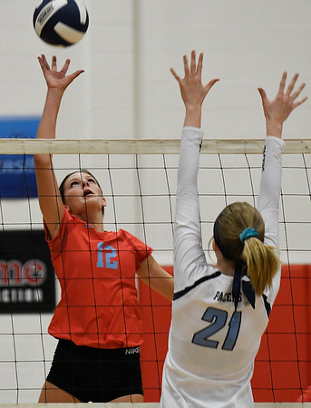 Chisholm's Courtney Petersen hits the ball against Enid's Emily Peterson Tuesday August 21, 2018 at the NOC Mabee Center. (Billy Hefton / Enid News & Eagle)