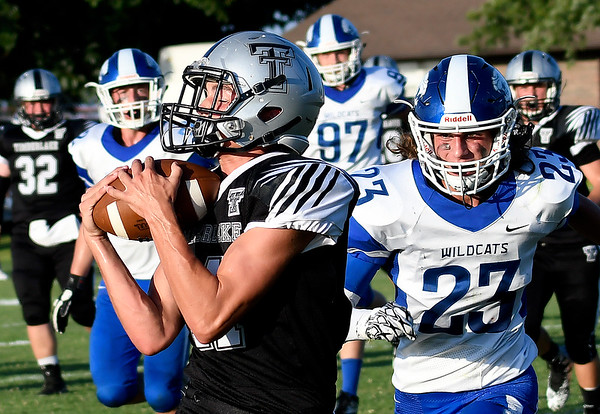 Timberlake's Alec Judd catches a 2 point conversion behind Covington-Douglas' Dalton Fleeson Thursday August 23, 2018 at Timberlake High School in the season opener for both teams. (Billy Hefton / Enid News & Eagle)