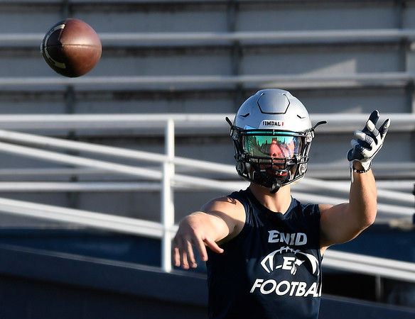 Enid's Titan Stephens throws a pass during the first day of practice Monday August 6, 2018 at D. Bruce Selby Stadium. (Billy Hefton / Enid News & Eagle)