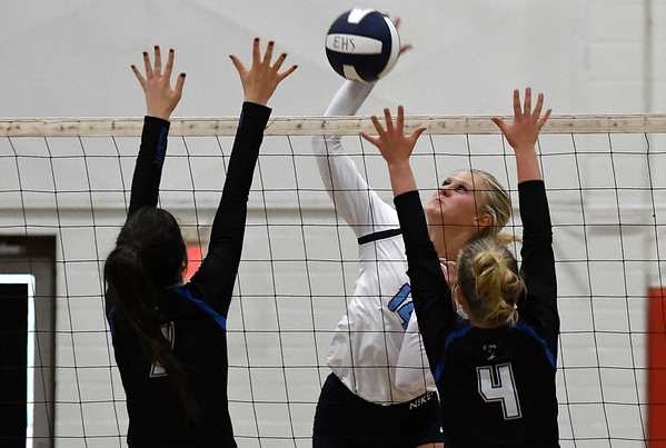 Enid's Hanna Brinley hits the ball against Choctaw's Kylee Steelman and Josie Thomas Friday August 17, 2018 at the NOC Mabee Center. (Billy Hefton / Enid News & Eagle)