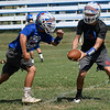 Waukomis' Matt Buck hands the ball to James Busbee during practice Thursday August 30, 2018 at Waukomis High School. (Billy Hefton / Enid News & Eagle)