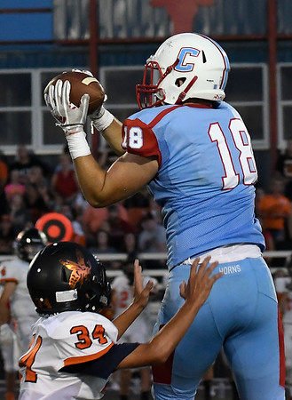 Chisholm's Noah Hann catches a pass over Fairview's Parker Chance August 31, 2018 at Chisholm High School. (Billy Hefton / Enid News & Eagle)