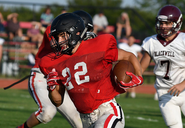 OBA's William Price carries the ball during a scrimmage against Blackwell Thursday August 16, 2018 at Oklahoma Bible Academy. (Billy Hefton / Enid News & Eagle)