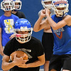 Waukomis' Devin Wagoner carries the ball during practice Thursday August 16, 2018 inside the Waukomis Indoor Practice Facility. (Billy Hefton / Enid News & Eagle)