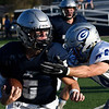 Enid's Titan Stephens runs the ball against Guthrie's Cade Whitfield Friday August 24, 2018 at D. Bruce Selby Stadium. (Billy Hefton / Enid News & Eagle)