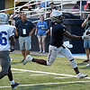 Enid's Will Phillips extends the ball over the goaline to score a touchdown against Guthrie Friday August 24, 2018 at D. Bruce Selby Stadium. (Billy Hefton / Enid News & Eagle)