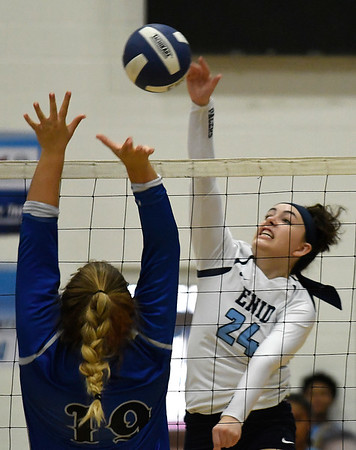 Enid's Gabi Cotarelo hits the ball against Stillwater's McKenzie Vilade Tuesday August 28, 2018 at the NOC Mabee Center. (Billy Hefton / Enid News & Eagle)