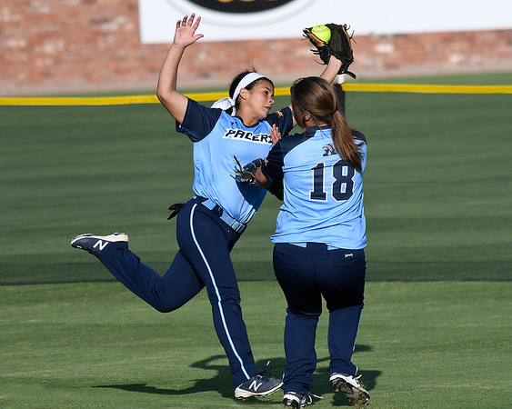 Enid's Tori Jackson collides with Haylee Schwandt (18) after making a catch in centerfield against Tulsa Union Monday August 20, 2018 at David Allen Memorial Ballpark. (Billy Hefton / Enid News & Eagle)