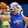Waukomis' Matt Buck throws a pass during practiceThursday August 16, 2018 inside the Waukomis Indoor Practice Facility. (Billy Hefton / Enid News & Eagle)
