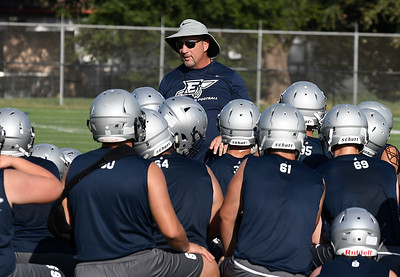 Enid head coach, Steve Hayes, talks to his players during the first day of practice Monday August 6, 2018 at D. Bruce Selby Stadium. (Billy Hefton / Enid News & Eagle)