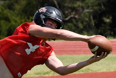OBA's Traber Smithson catches a pass during the first day of practice Monday August 6, 2018 at Oklahoma Bible Academy. (Billy Hefton / Enid News & Eagle)