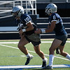 Enid's Titan Stephens takes the handoff from Blake Priest during practice Thursday August 30, 2018 at D. Bruce Selby Stadium. (Billy Hefton / Enid News & Eagle)