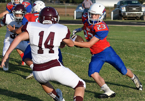 DCLA's Tobyn Snow cuts upfield in front of Waynoka's Drake Brady while returning a kickoff Thursday August 30, 2018 at Deer Creek-Lamont High School. (Billy Hefton / Enid News & Eagle)