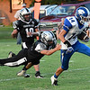 Covington-Douglas' Dawson Aldrich pulls away from Timberlake's J.J. Pippin to score a touchdown Thursday August 23, 2018 at Timberlake High School in the season opener for both teams. (Billy Hefton / Enid News & Eagle)