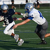 Enid's Jadon Dimarucut tries to get by Guthrie's D.J. Coonfield Friday August 24, 2018 at D. Bruce Selby Stadium. (Billy Hefton / Enid News & Eagle)