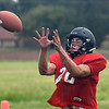 OBA's William Price catches a pass during a defensive drill Monday August 13, 2018 at Oklahoma Bible Academy. (Billy Hefton / Enid News & Eagle)
