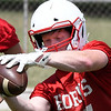 Chisholm's T.C. Smith catches a pass during drills on the first day of practice Monday August 6, 2018 at Chisholm High School. (Billy Hefton / Enid News & Eagle)