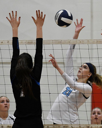 Enid's Emily Peterseon hits the ball against Choctaw's Kylee Steelman Friday August 17, 2018 at the NOC Mabee Center. (Billy Hefton / Enid News & Eagle)