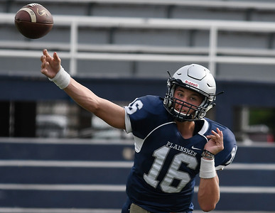 Enid's Blake Priest throws a pass during the first practice in pads Friday August 10, 2018 at D. Bruce Selby Stadium. (Billy Hefton / Enid News & Eagle)