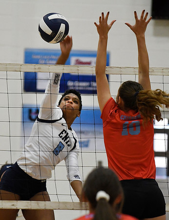 Enid's D'Sani Levy hits the ball pass Chisholm's Raylee Savage Tuesday August 21, 2018 at the NOC Mabee Center. (Billy Hefton / Enid News & Eagle)