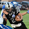 Timberlake's Devon Kent is grabbed by Covington-Douglas' Dawson Aldrich Thursday August 23, 2018 at Timberlake High School in the season opener for both teams. (Billy Hefton / Enid News & Eagle)