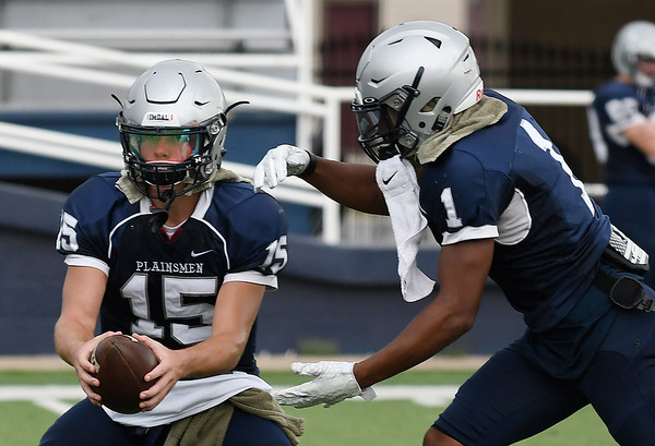 Enid's Titan Stephens (15) and Will Phillips during practice Thursday August 17, 2018 at D. Bruce Selby Stadium. (Billy Hefton / Enid News & Eagle)