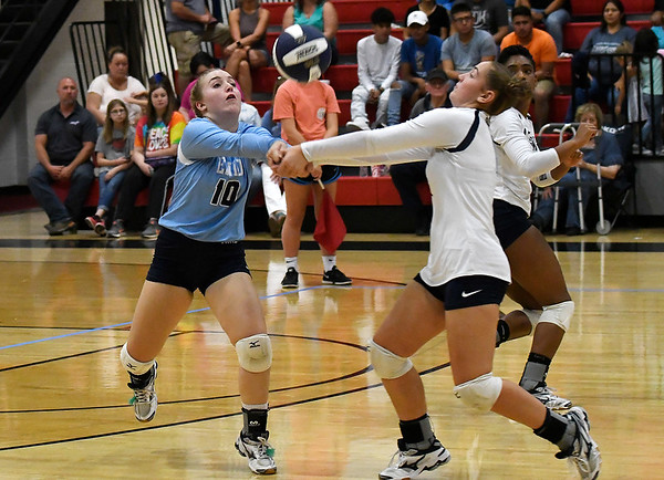 Enid's Kayla Kelley and Kelci Wilson volley the ball against Choctaw Friday August 17, 2018 at the NOC Mabee Center. (Billy Hefton / Enid News & Eagle)